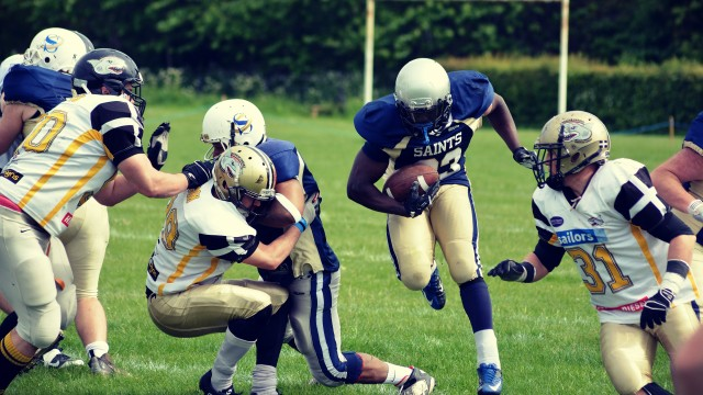 Mike Oluwole picks up yards (by Chris Janes) web cover